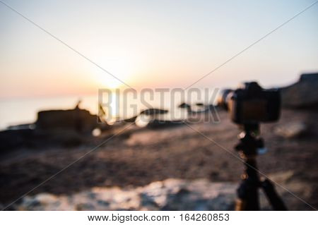 Defocused photo of the camera on tripod. Preparations for photography scenery