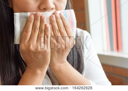 The illness woman using tissues when coughing gag