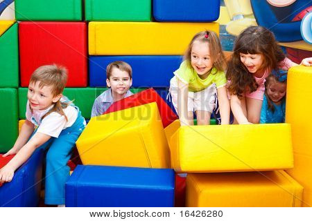 Kids play with leather bricks
