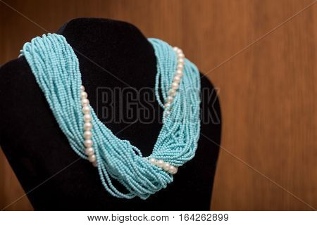 Jewelry turquoise color on a black mannequin