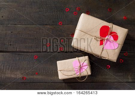Background Valentine's Day. Valentine Day Day Or Birthday Presents With Paper Heart On A Wooden Tabl