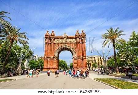 Barcelona, Spain - May 27, 2016: many tourists near the Arc de Triomphe in sunny summer day