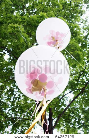White helium balloon over tree in sky. wedding day