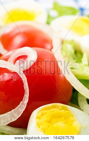 Cherry Tomatoes And Boiled Eggs In A Salad With Lettuce Leaves,