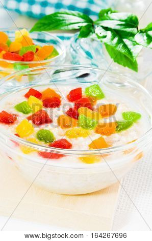 Oatmeal With Colorful Candied Fruits In A Glass Bowl