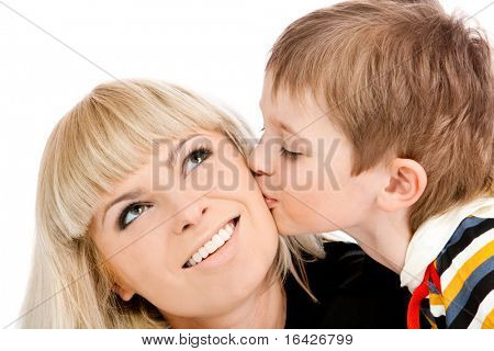 Portrait of a preschool boy kissing his mother