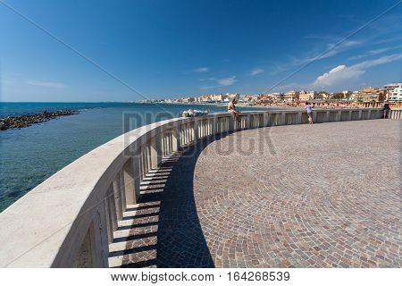 Lido di Ostia ITALY - September 14 2016: Relaxing people on the pier (Pontile Di Ostia) near beautiful beach Lido di Ostia ( Lido di Roma) Italy.