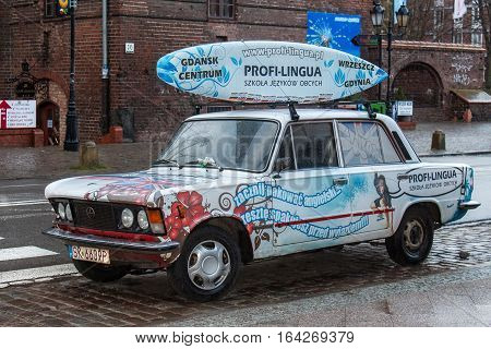 POLAND GDANSK - DECEMBER 18 2011: Old car Fiat 125p in the Gdansk. The Polski Fiat 125p is a motor vehicle manufactured between 1967 and 1991 in Poland by the manufacturer FSO agreement with Fiat.