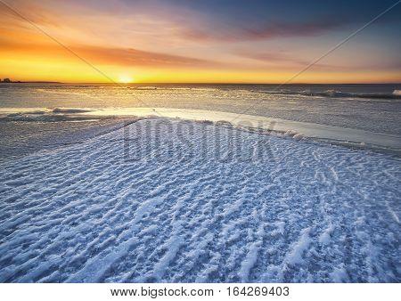 Winter sea during sundown. Beautiful winter seascape