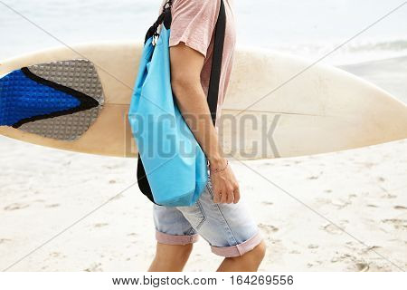 Hobby, Active Lifestyle And Extreme Sports. Young Caucasian Surfer Running With Bodyboard Into Water
