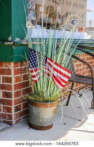 Patriotic bucket of grasses outside a store in Beaufort, SC