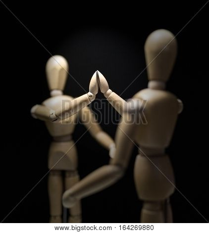 Wooden Mannequins-hi5-close-focusBlur-overshoulder 01 - Shot close in with focus blur and from behind the right mannequin.