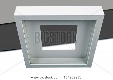 abstract picture frame against grey background, studio shot