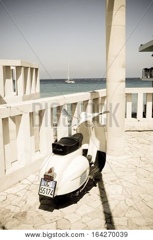 8 august 2014-otranto-italy- beautiful Vespa scooter in a southern Italian beach filter with aged photositaly