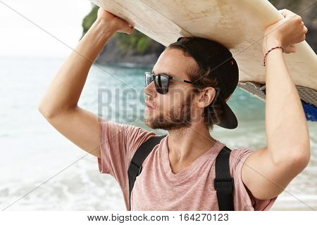 Surfer Lifestyle During Summer Travel Vacation. Close Up Portrait Of Young Attractive And Handsome T