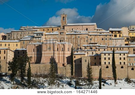 Winter view of Nocera Umbra medieval village covered by snow