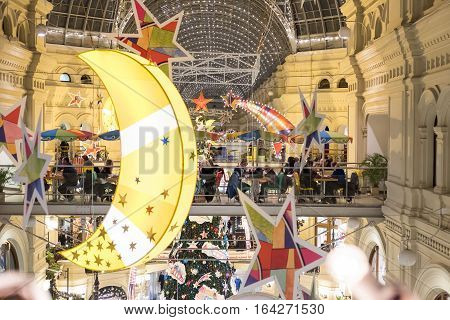 Moscow, Russia. 16 December 2016 : People Walking In Gum Mall With Christmas Stars, Moon, Lighting A
