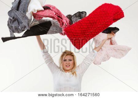 Woman Throwing Big Piles Of Clothing