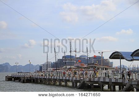 People Are Leaving Pier For Tourist Ferries In Ha Long Bay, Vietnam