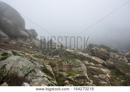 The mountain of Monsanto in the fog Portugal