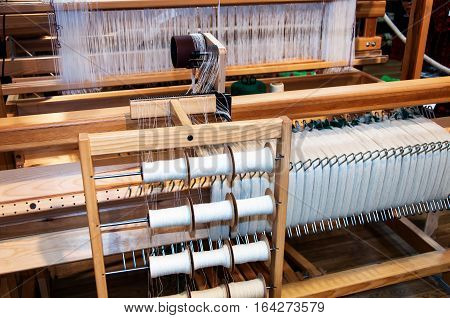 Weaving on a old traditional wooden loom