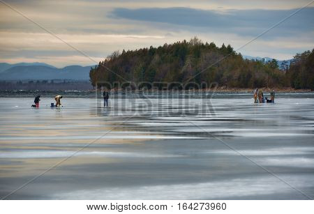 Men Ice Fishing on Lake Champlain in Late Afternoon
