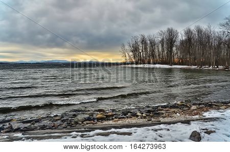 Lake Champlain in winter looking west. The foothills of the Adirondack Mountains of can be seen over the western shore of the lake.