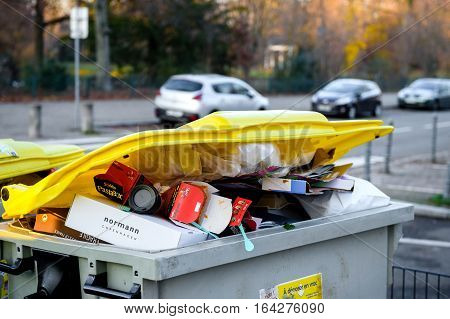 STRASBOURG FRANCE - DEC 19 2016: Dumpsters being full with garbage before winter holidays