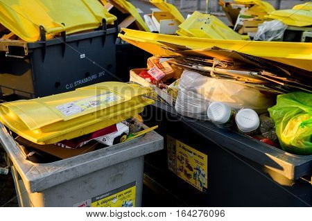 STRASBOURG FRANCE - DEC 19 2016: Close-up detail of dumpsters being full with garbage before winter holidays