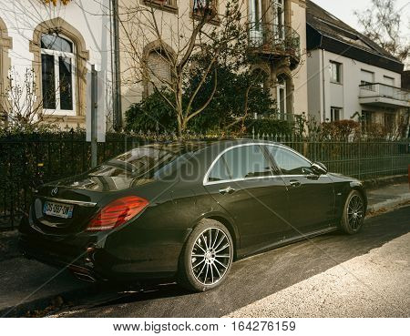 STRASBOURG FRANCE - NOV 29 2016: Rear view of Luxury Mercedes-Benz S Klass limousine parked in front of a luxury house
