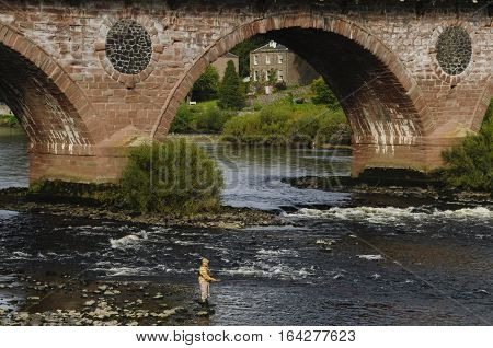 Perth, Scotland, Uk - 09 Sep 2014: A Middle Aged Man Fly Fishing On The River Tay In Perth Scotland
