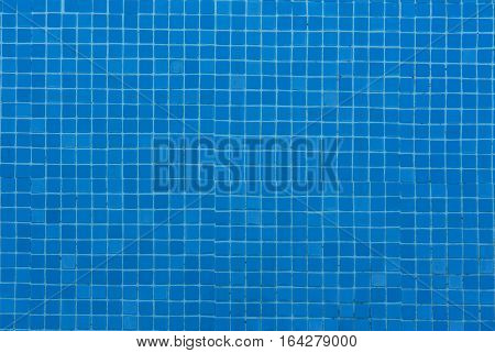 Blue ceramic tile mosaic in water swimming pool - seamless texture photo