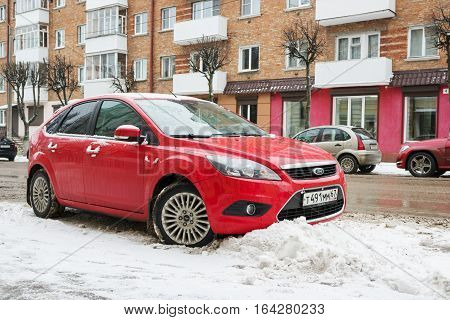 Smolensk, Russia - December 01, 2016: New car Ford Focus parked in winter street after snowfall.