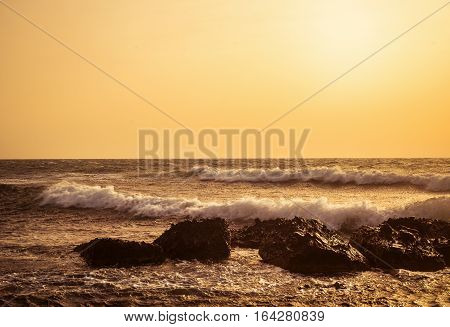 close up shot of the stone beach at sunset