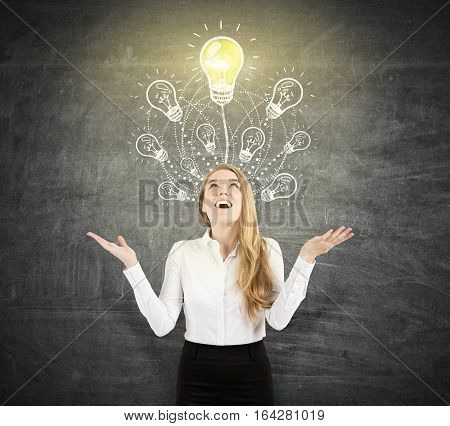 Happy Blond Woman Near Light Bulb On Blackboard