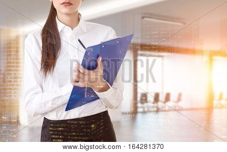 Close up of a businesswoman holding a blue clipboard and standing in an office corridor. There are two meeting rooms in the background. 3d rendering. Toned image. Mock up. Double exposure