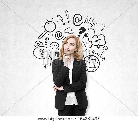 Portrait of a red haired businesswoman standing near a concrete wall and thinking. There is an internet search sketch on the wall.