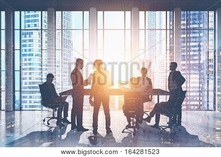 Businessmen Meeting In Skyscraper
