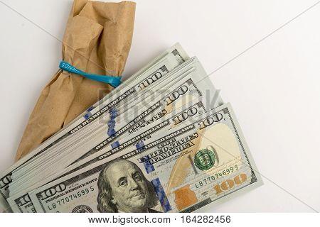 Stack of hundred dollar bills banknotes and envelope