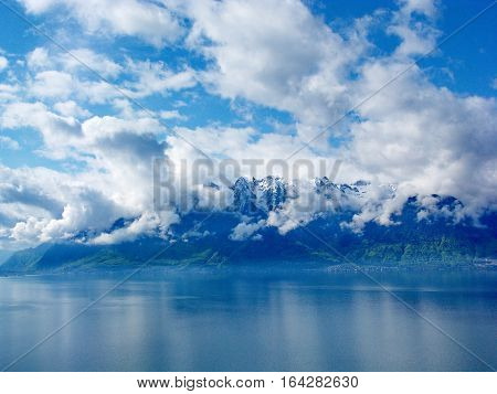 Cotton over Lac Leman (Lake Geneva). Clouds clinging to the hills on the south side of the lake.