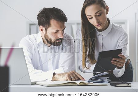 Boss With Book And Secretary With Calculator