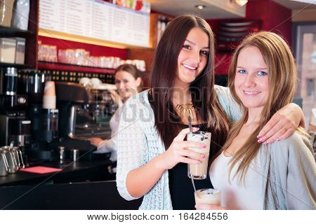 friends getting a cup of coffee at a cafe