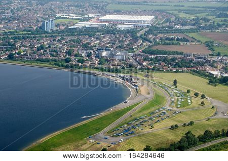 View from a plane of the Queen Mother Reservoir and Datchet Sailing Club in Berkshire on a sunny morning in June.