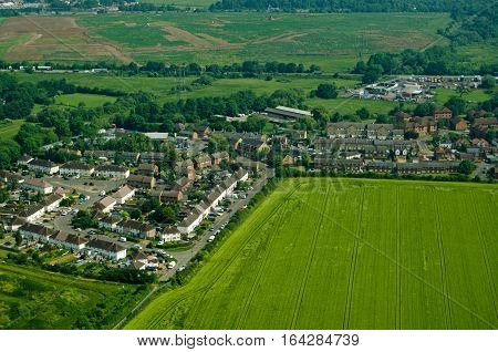 View from a plane of part of the village of Colnbrook Berkshire on a sunny morning in June.