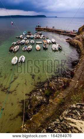 Boats in a scenic Cornwall Harbour with clouds
