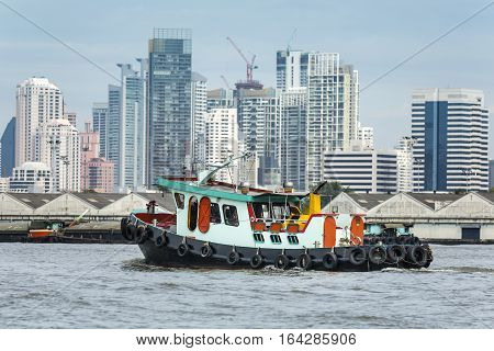 tugboat assist cargo ship was sailing on the river in the city