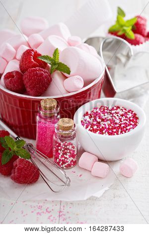 Valentines day baking concept, sprinkles, cookie cutters and marshmallows