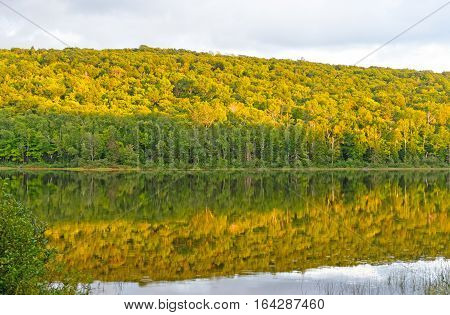 Fall Colors at Sunset on a Lake of the Clouds in Porcupine Mountains State Park in MIchigan