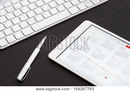 Tablet Computer On On The Black Table