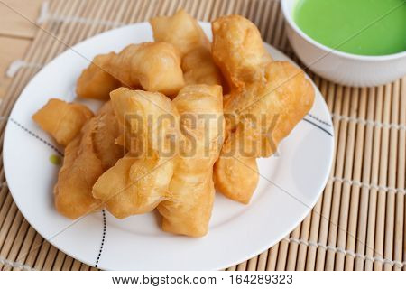 Chinese bread stick or chinese donut and pandan coconut custard dip